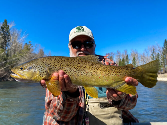 Marcelo with a dry fly fishing river monster