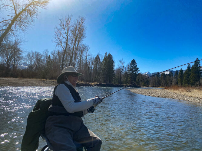 Nancy has a trout on the line on the Bitterroot