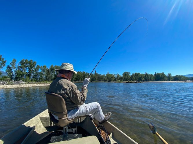 Jim hooked up on a blue bird day - Trout Fishing Montana