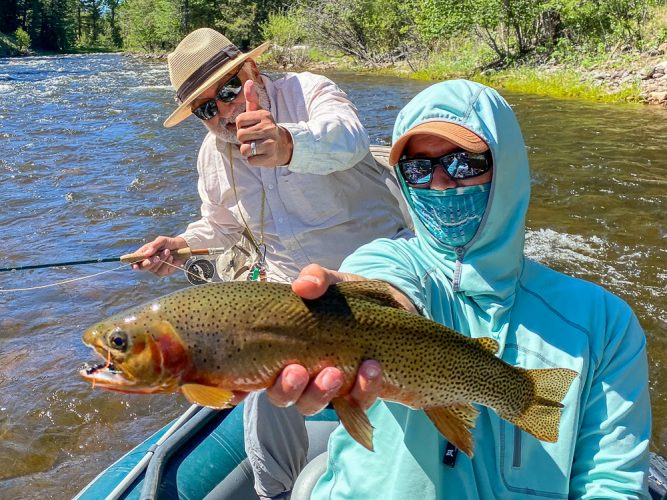 Marcelo with a fat cutthroat in the morning - Trout Fishing Montana